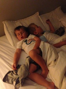 When dad's out of town, boys sleep with mom.  This is how I found them - cuddled up to each other.