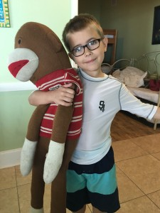 Jack was in love with this monkey, and begged that we let him keep it.  The monkey had to stay at the condo we rented, but we got to keep this picture of him.