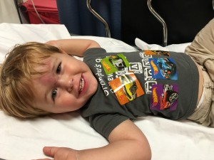 Still all smiles after the CAT scan - stickers everywhere