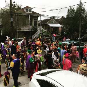 A crew in a walking parade (with one float) rolls right by our house - this is from my front porch on Mardi Gras day! That's my white car!
