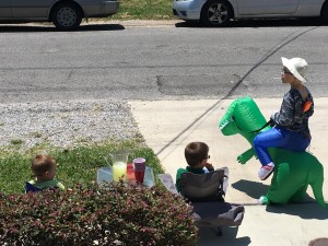 They set up a Dino-Man Lemonade stand. Sold very little. I told them $2  a glass was too steep.