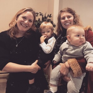 My sister holds her baby (right), our cousin holds her youngest (left)