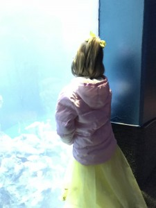 Birthday girl at Finding Nemo ride - the aquarium after.