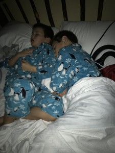 Clutching his brother