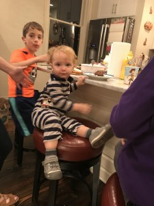 This big boy wanted to sit on a stool with the big kids.