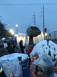 E.T., wearing a poncho at this time to keep him from dissolving in the rain, and later sporting a jester hat.  Also, the brain in front of him was part of a krewe of people who all wore elaborate brain hats.  I can't do it justice with words, but it was amazing.